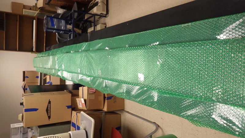 8 Photo Of Completed LED Ticker Bars Individually Wrapped In Protective Bubble Wrap And Stored Off The Floor On A Benchtop. It Is Important That These Are Handled With Care When Moving And Avoid Stacking Anything